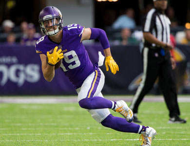 Adam Thielen running with football